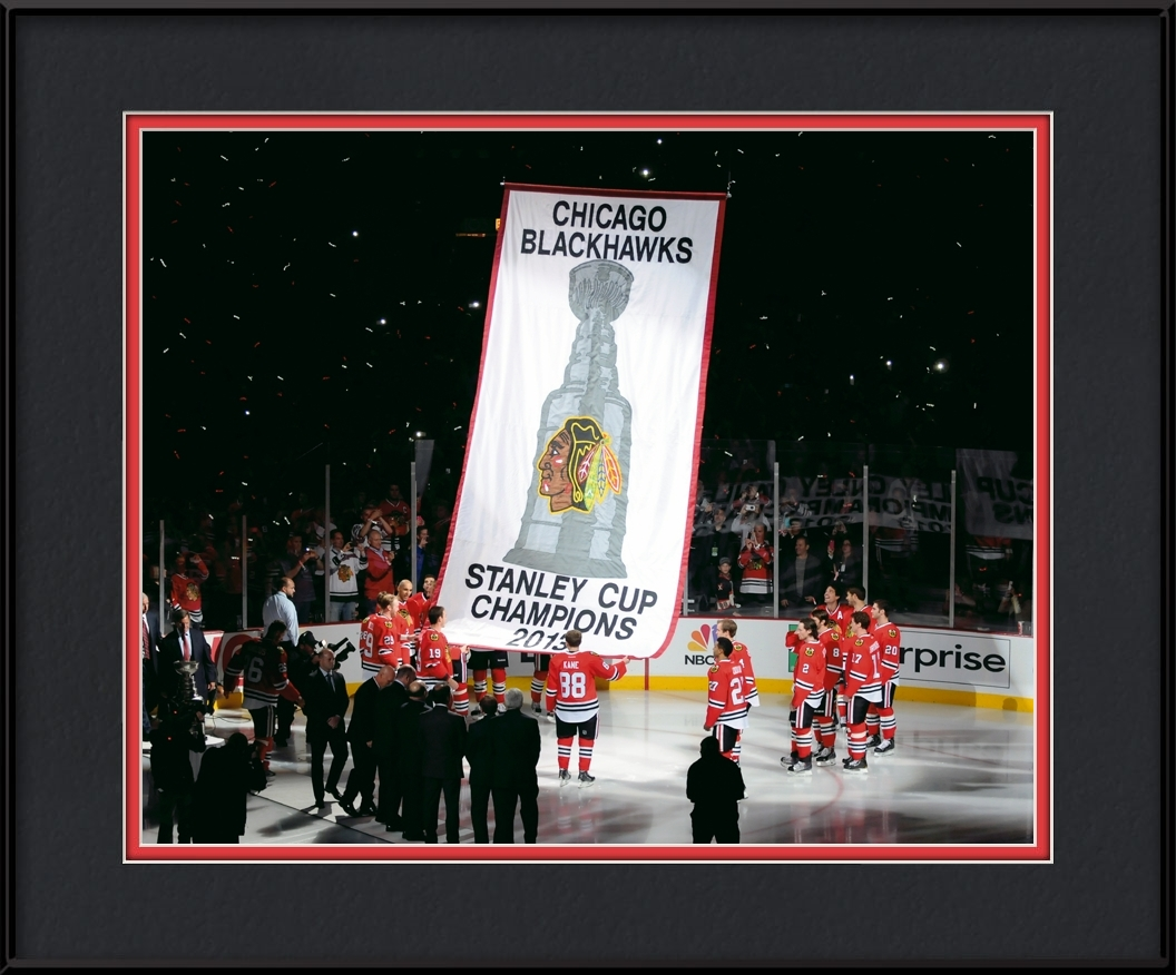framed-print-of-blackhawks-raising-banner-2013-champions