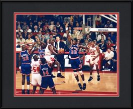 framed-print-of-michael-jordan-soars-over-ewing