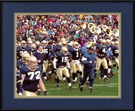 framed-print-of-lou-holtz-leading-notre-dame-football-team-onto-field