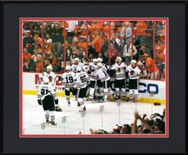 picture-of-team-celebrating-after-patrick-kane-game-winning-shot