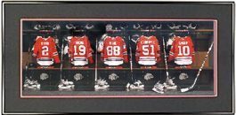 framed-print-of-blackhawks-locker-room-jerseys