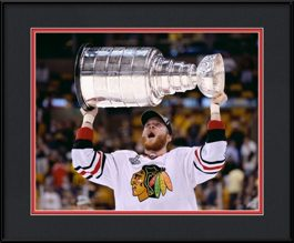 picture-of-bryan-bickell-raising-the-stanley-cup