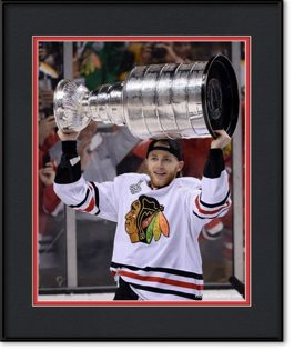framed-print-of-patrick-kane-lifting-the-stanley-cup