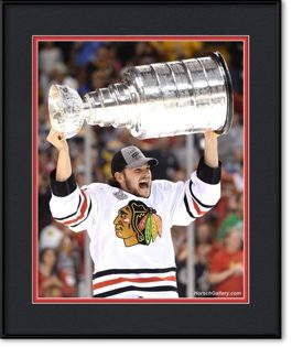 michael-frolik-lifting-the-stanley-cup-framed-picture
