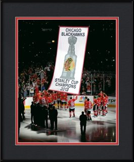 framed-print-of-kane-sharp-raise-blackhawks-banner